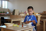 Montessori Practical Life activities help children learn many skills. By polishing this wooden bowl, this boy is learning to manage a multi-step process involving many materials. He's working on fine motor skills. He's extending his attention span. And, of course, he's having fun!