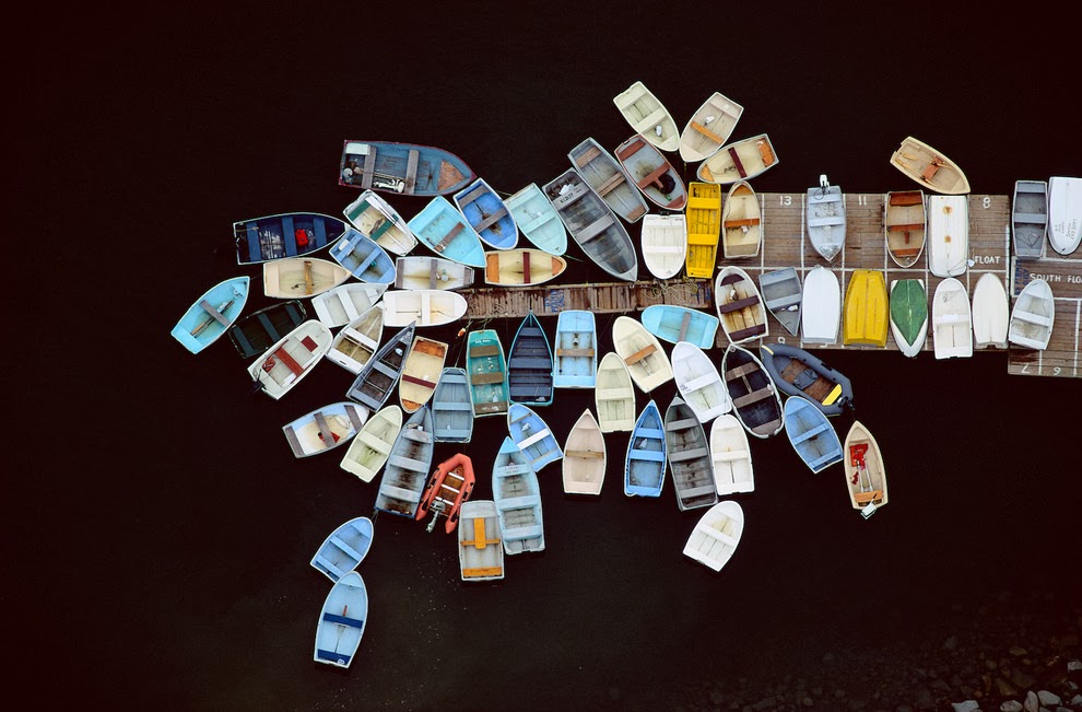 Dinghies clustered around dock, Duxbury, Massachusetts, USA, 1993.
