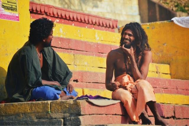 Varanasi Ganges Man Food Street Photography laughing sadhu
