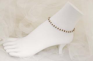 "Corona - Pearls & gold metal spacers  8 1/2""   $18"