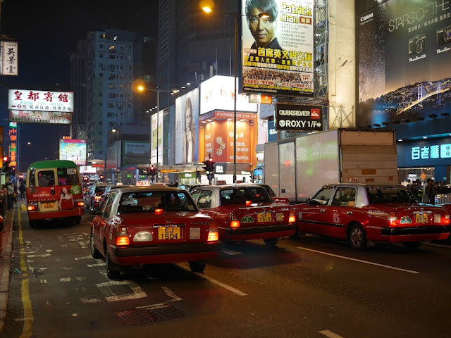 several taxis and a minbus in Mong Kok