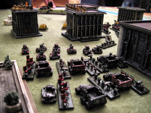 Spectrar Ghost's Orks face off against m_folias' Imperial Fists.