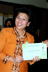 Ministy of Women's Empowerment and Children Protection Government of Indonesia, Mrs. Linda Gumelar holding a Wali Pohon Certificate