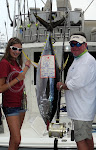 Jamie Jenkins with her Dad, Ron weighing in her Ahi at 120 Pounds!  Nice Going Jamie!  July 18, 2012