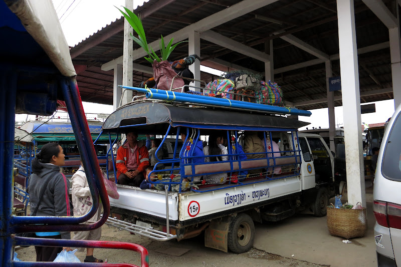 Overloaded tuk-tuk at Luang Prabang bus station