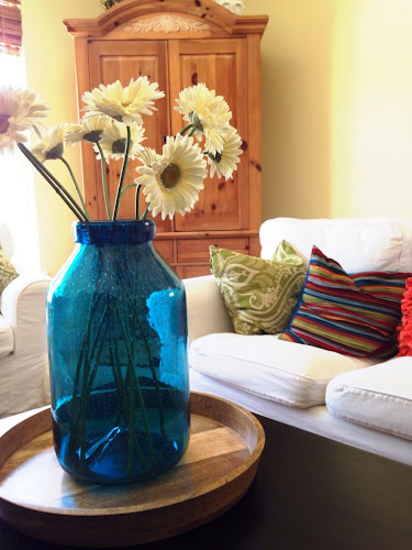 Bright and bold family room, target bubble glass vase, what colors mean