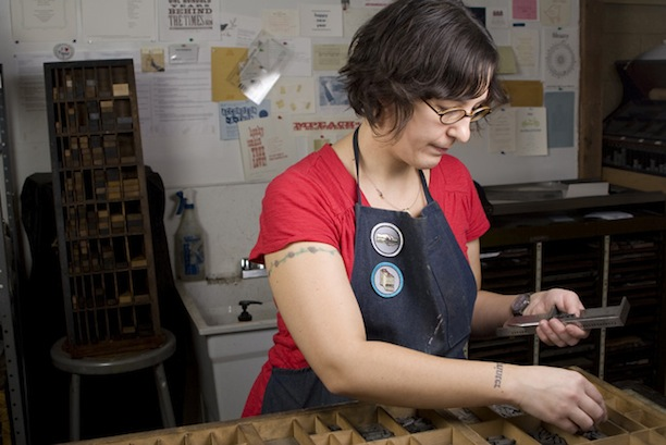 lisa hasegawa of ilfant press setting type in a letterpress