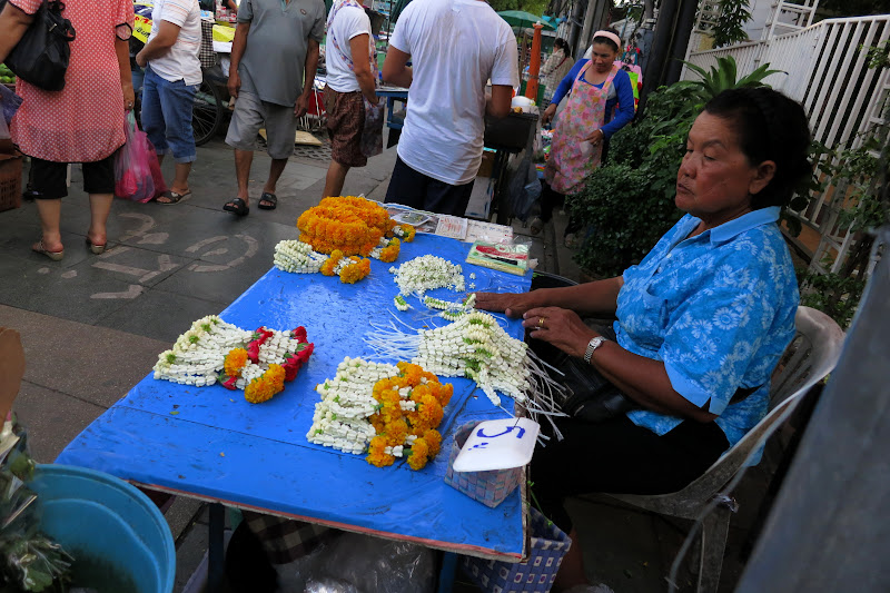 Woman selling flower offerings