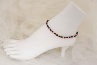 "Firelight - Red & silver crystals, black  glass and silver metal beads  9""   $18"