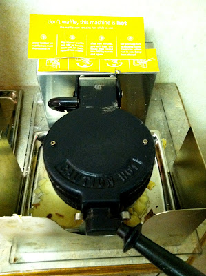 Hampton Inn waffle maker breakfast stock photo