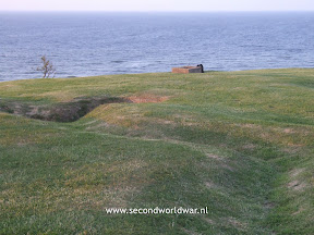 What is left today of renches on top of the hill at omaha beach