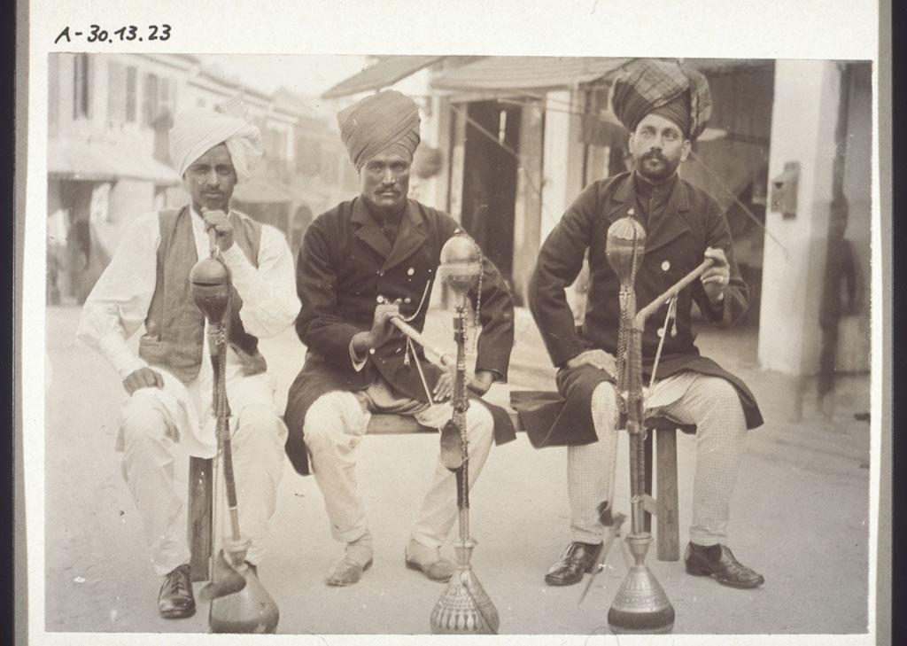Indian Sikh Policemen In Hong Kong Smoking Water Pipes.