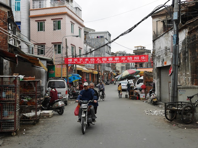 two men on a motorbike in Yangjiang, China