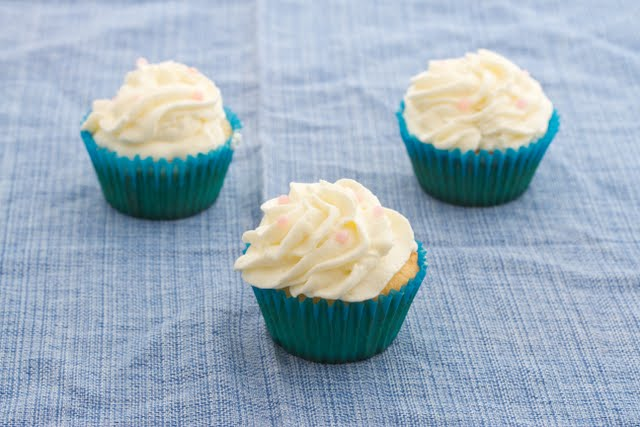photo of three vanilla cupcakes