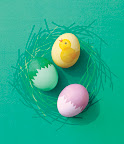 these cracked eggs are easy to make with sticky vinyl... and the chick is stenciled on with food coloring.