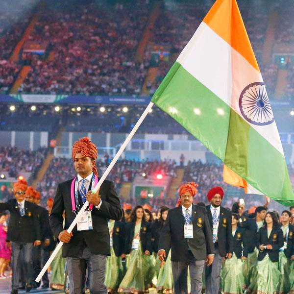 India's flag bearer Vijay Kumar leads the team into the arena during the opening ceremony for the Commonwealth Games 2014 in Glasgow, Scotland, Wednesday July 23, 2014.