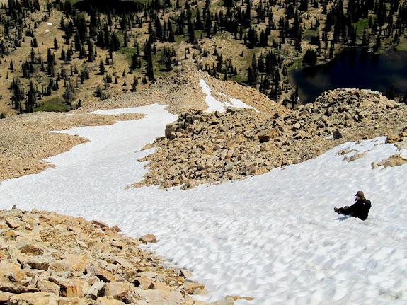 Chris glissading down the ridge