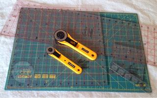 Rotary cutter, ruler, mat.