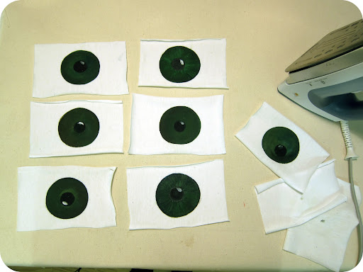 Odd is always good—I made 7 eyes for the t-shirt. Once completely dry, I ironed each one in between some scrap fabric.