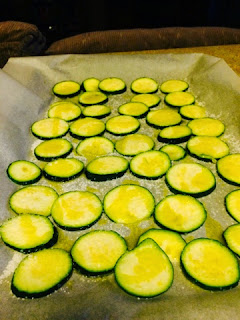 Sliced zucchinis ready for the oven