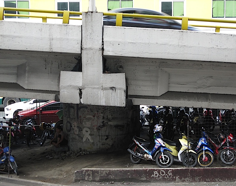 motorcycle parking under a flyover