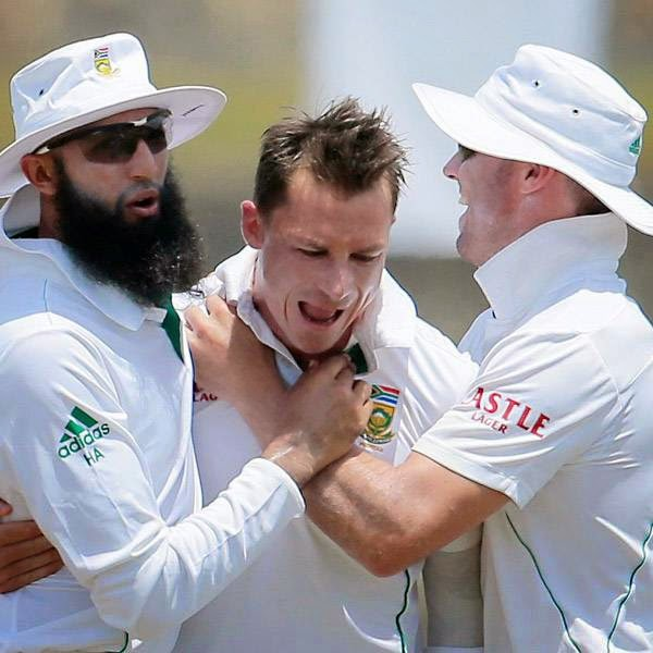 South African test cricket captain Hashim Amla, left, and AB de Villiers, right, congratulate bowler Dale Steyn for the dismissal of Sri Lankan batsman Dilruwan Perera during the fifth day of the first test cricket match in Galle, Sri Lanka, Sunday, July 20, 2014.