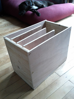 Wooden laptop holder with four upright slots