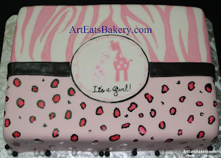 Hand painted pink, black and white fondant zebra, leopard and giraffe girl's baby shower cake
