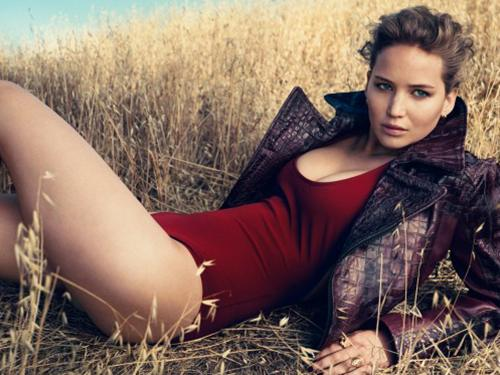 Jennifer Lawrence is the lady in red today.  She wore a leotard for Vogue Magazine.