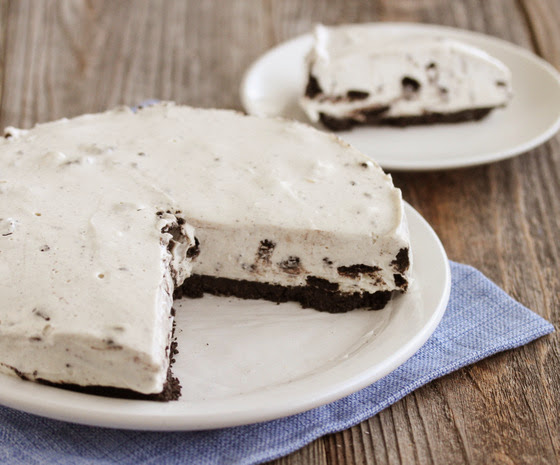 photo of an oreo cheesecake with a slice on a plate