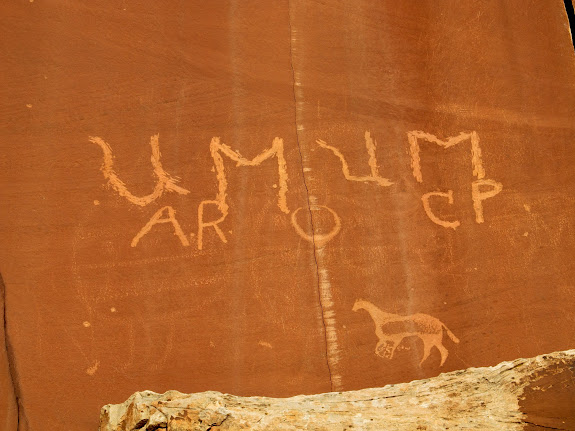 Old inscriptions, abraded shield figures, and probably a Ute horse petroglyph