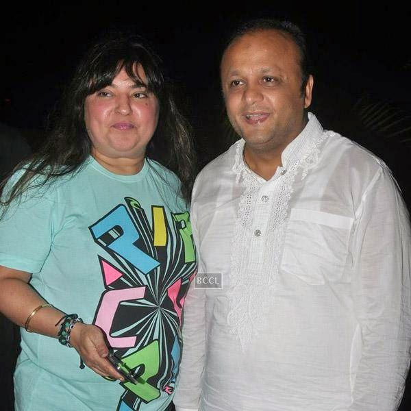 Dolly Bindra poses with a guest during Sangram Singh's birthday party, held at Churchgate, on July 20, 2014.(Pic: Viral Bhayani)