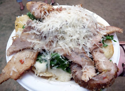 Traegar Smoked Food Forest Farm's Berkshire Pork Porchetta, Served Open Faced on House -made (gluten free) Focacceta Rolls Drenched in Smoky Pork Jus Topped with Nero and Ricotta Cheese at Bite of Oregon, taste from Oregon Bounty Chef's Table for $4