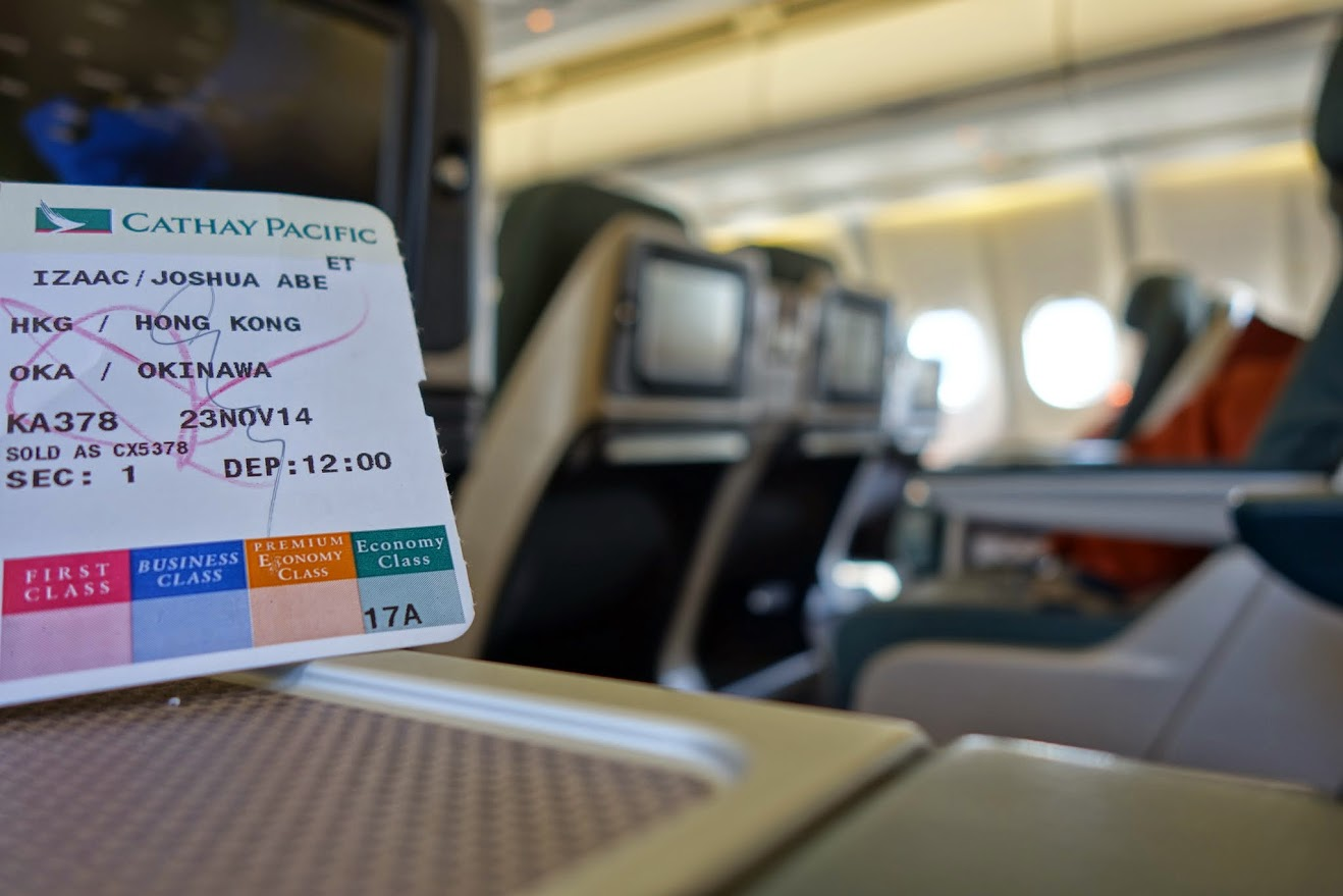 Economy ticket; business class seat
