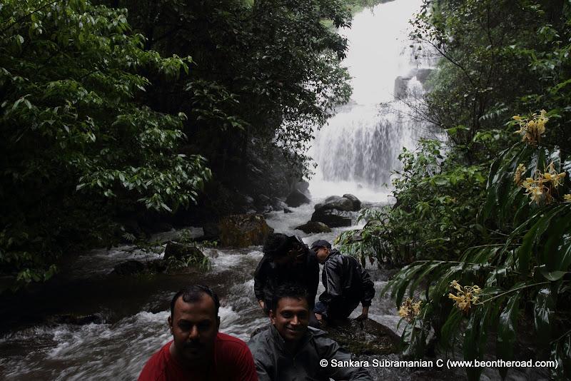 A happy bunch enoying the monsoon experience at Chingara Falls, Coorg
