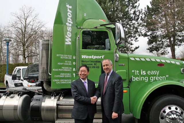 Yusuo Wang, Chairman, ENN Group and David Demers, Westport CEO, celebrate the new partnership in front of the Westport 15L powered Peterbilt 367 truck in Vancouver, B.C.