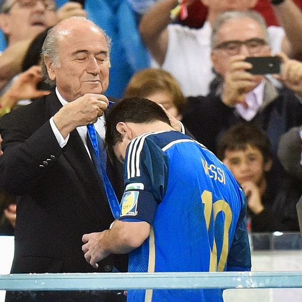 Argentina's Lionel Messi gets his runners-up medal from FIFA President Sepp Blatter after the World Cup final soccer match between Germany and Argentina at the Maracana Stadium, in Rio de Janeiro, on July 13, 2014.