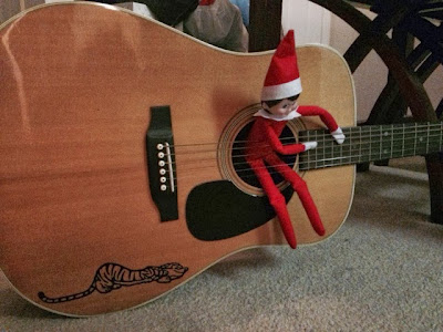Elf on the Shelf tunes up our guitar! www.thebrighterwriter.blogspot.com
