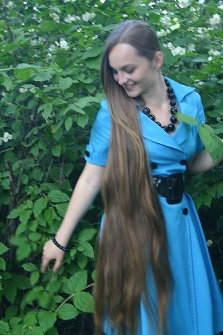 Amazing young woman with long hair, hair regrowth