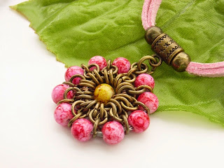 http://folksy.com/items/6512407-Pink-chainmaille-flower-necklace