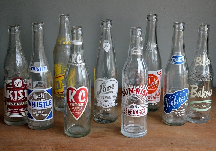 Assorted small soda bottles available for rent from www.momentarilyyours.com, $1.00 each.