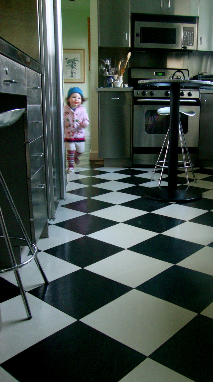 Classic black and white checkerboard floor for Black linoleum flooring