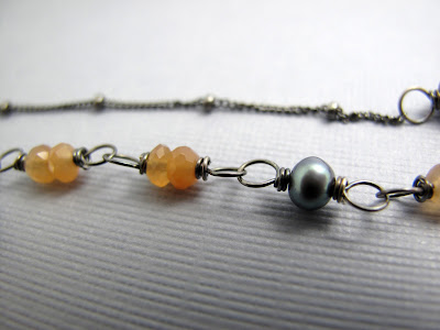 Embers & Ashes, Beth Hemmila (Hint Jewelry): grey pearls, orange moonstone,