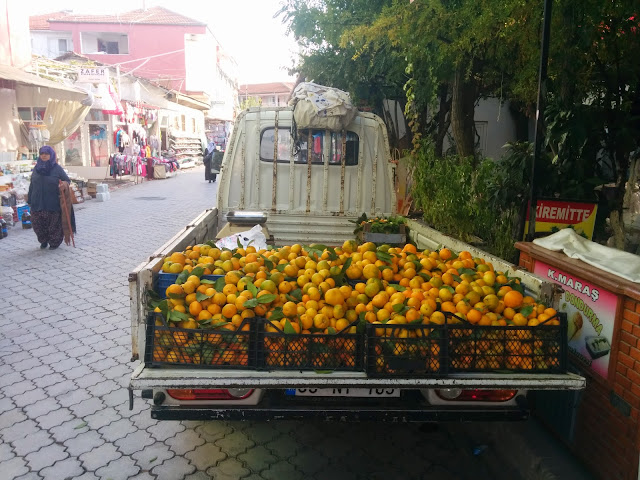 A truck full of oranges in a small Turkish village