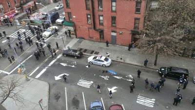 REVENGE: Two New York police officers shot dead by black gunman as revenge for two black youths shot by police..