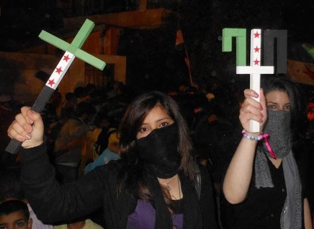 Syria's Christians make do with bombs for Christmas