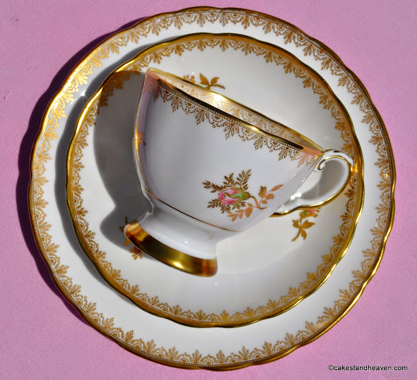 Tuscan gold and pink rose teacup, saucer, plate trio