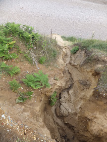 Rain channels down the cliff causing more erosion