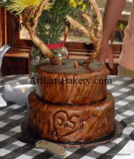 Edible deer antlers on wood grain with heart and initials carved in groom's cake 2