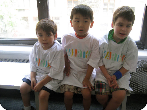 The boys wearing oversize Martha T-shirts as aprons.